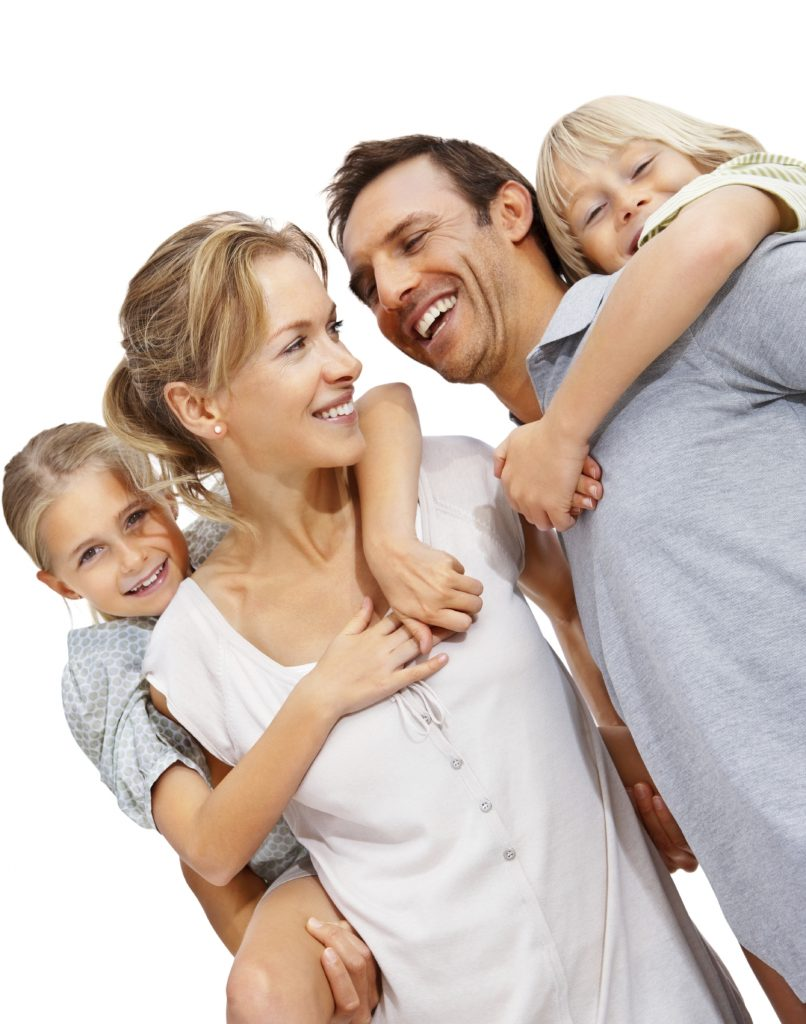 Portrait of a happy mature man and woman carrying kids on back at the beach